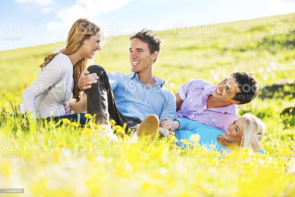 Beautiful couples resting together and talking royalty-free stock photo