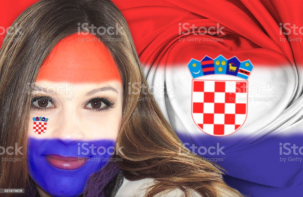 Beautiful Croatian woman in front of flag stock photo