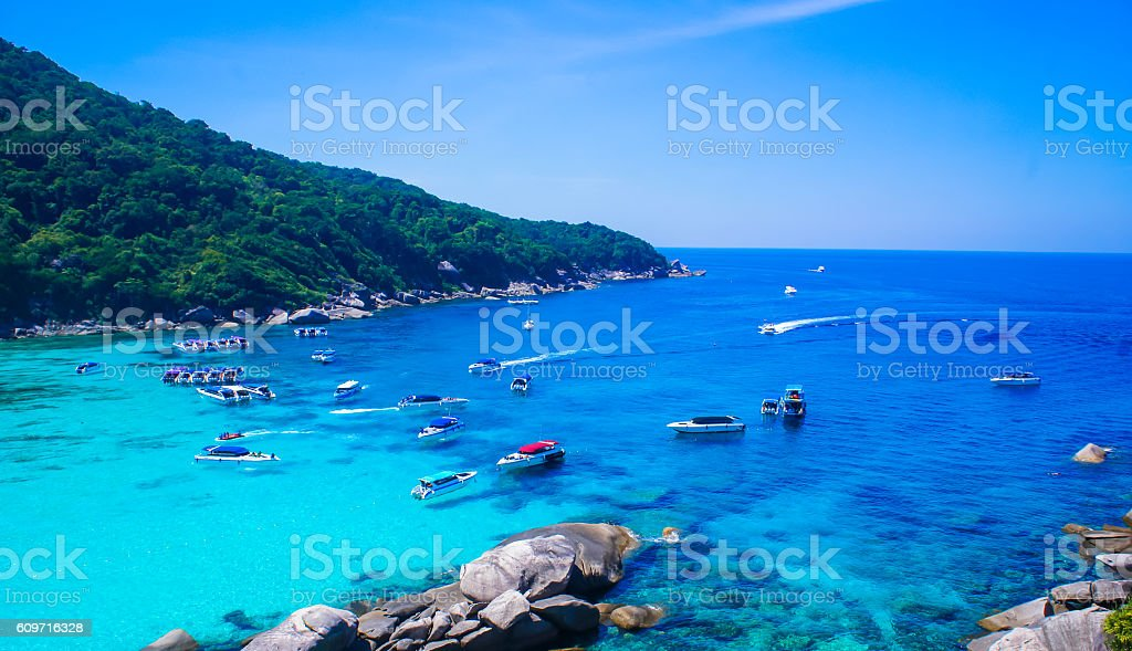 Beautiful crystal clear blue sea with groups of yachts stock photo