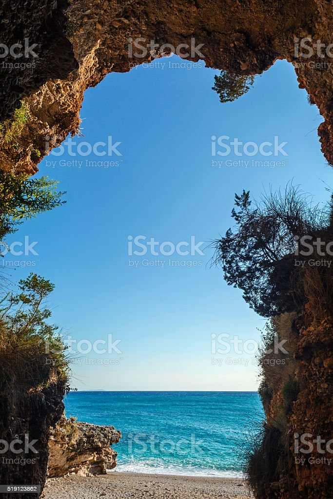 beautiful crystal clear sea view from inside cave stock photo