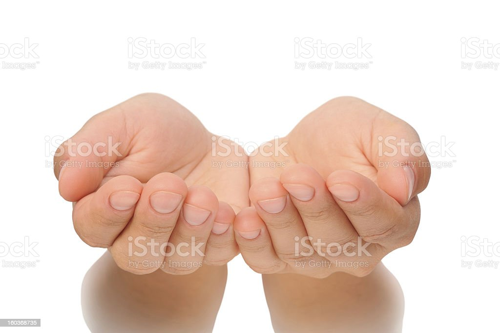Beautiful cupped hands of young woman - cut out stock photo