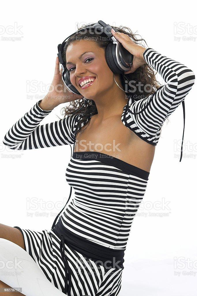 Beautiful curly brunette girl listening music royalty-free stock photo