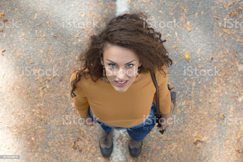 Beautiful curly girl with big blue eyes. Directly above view. stock photo
