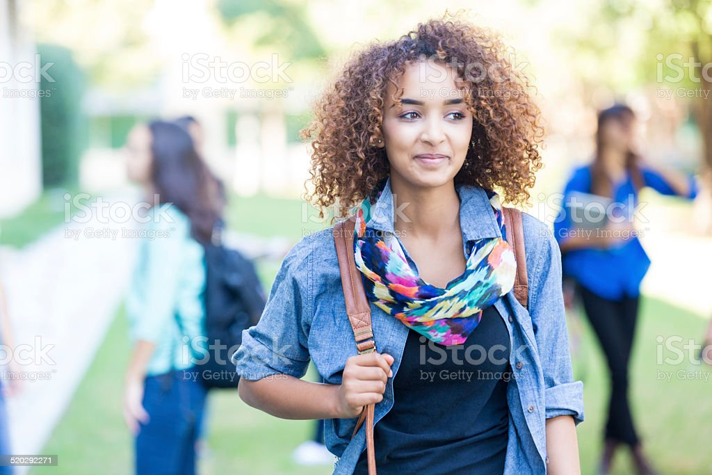 Beautiful curly haired African American college or high school student stock photo