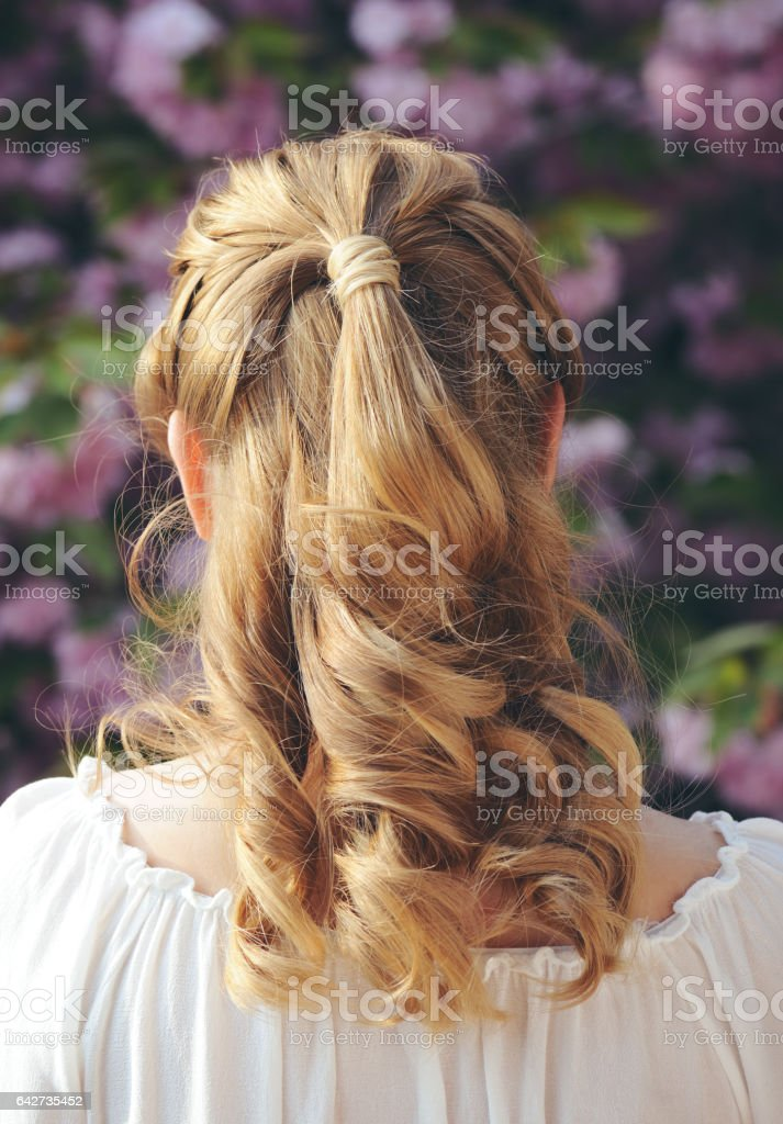 beautiful curly hairstyle stock photo