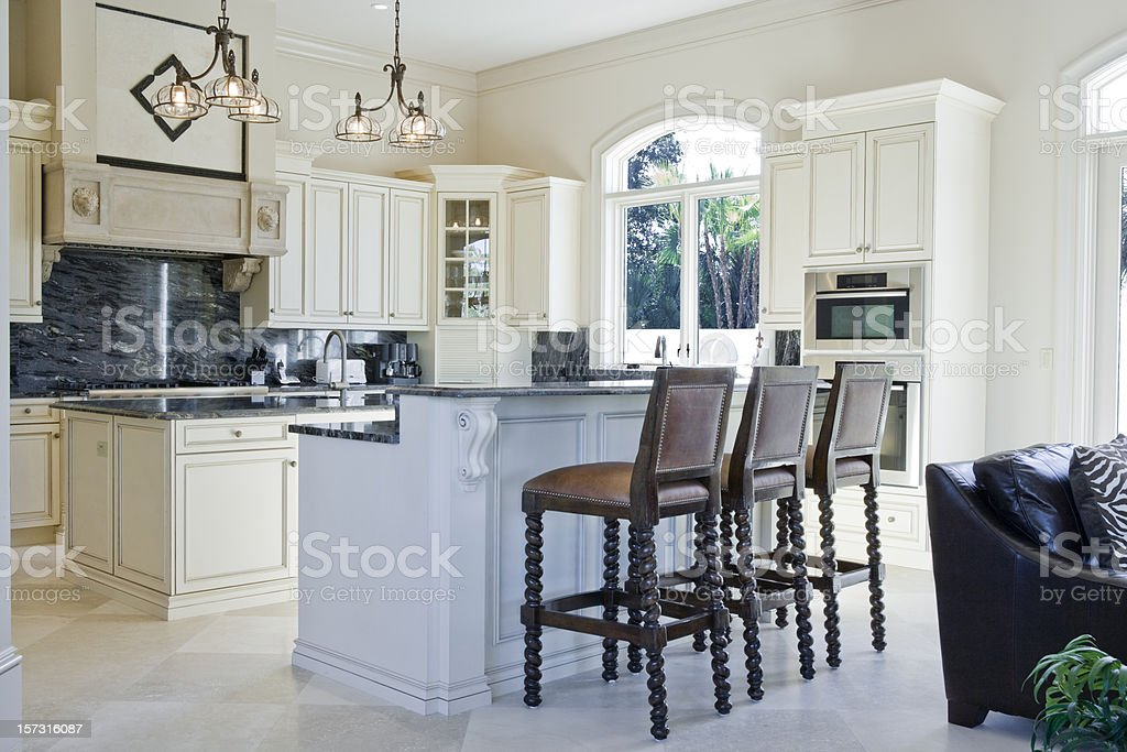 Beautiful Custom Kitchen with Breakfast Bar in Estate Home royalty-free stock photo