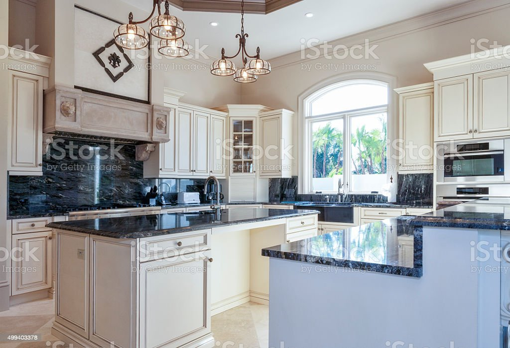 Beautiful Custom Kitchen with Island in Estate Home stock photo