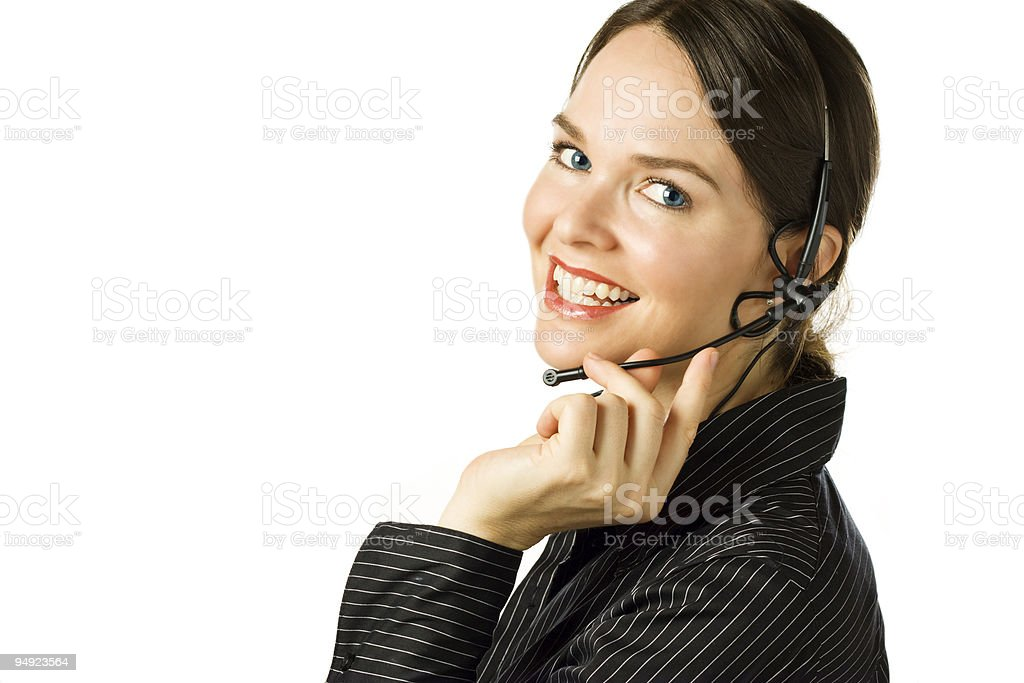 Beautiful customer service agent smiling during phone conversati royalty-free stock photo