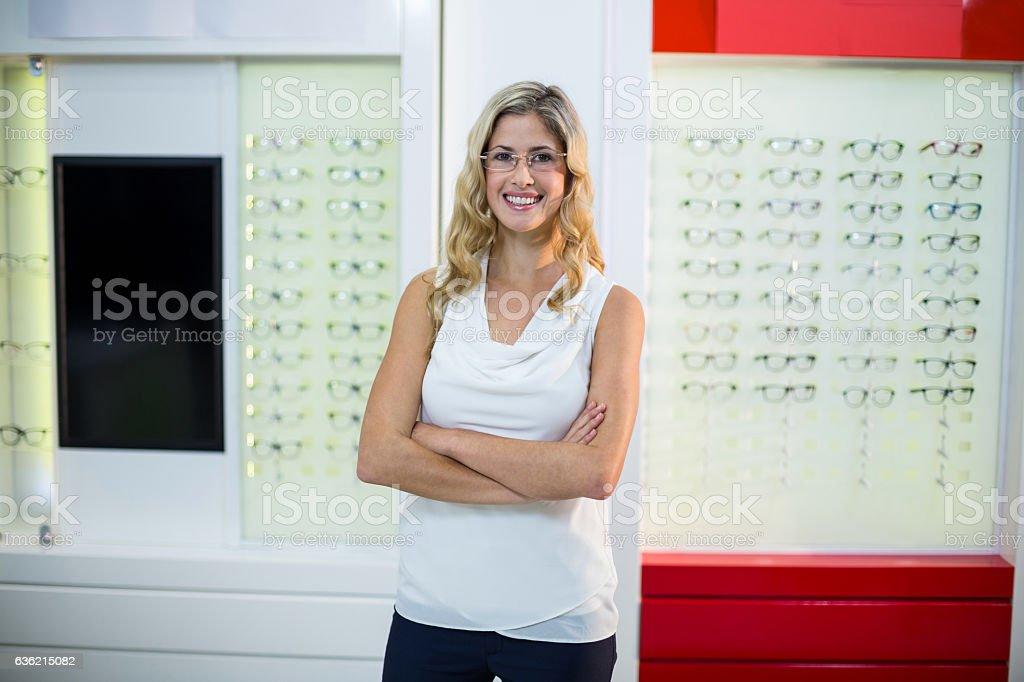 Beautiful customer standing in optical store stock photo
