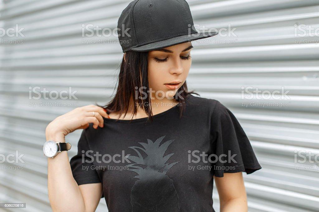 Beautiful cute girl in stylish black cap stock photo