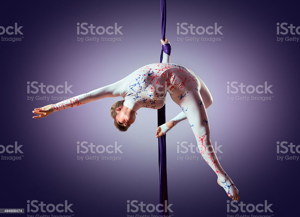 Beautiful dancer on aerial silk, aerial contortion, aerial ribbons stock photo
