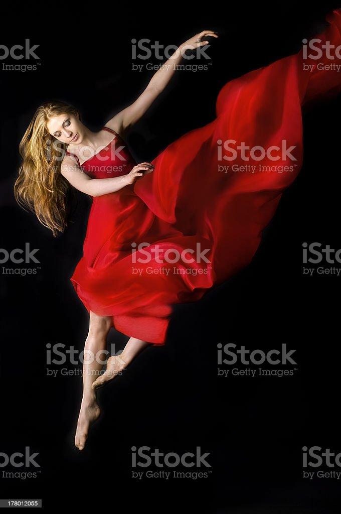 Beautiful dancer wearing red dress stock photo