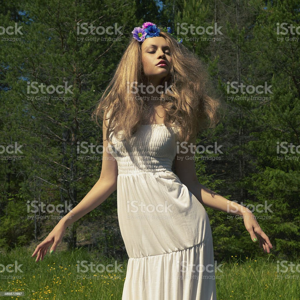 Beautiful dancing lady in the forest royalty-free stock photo