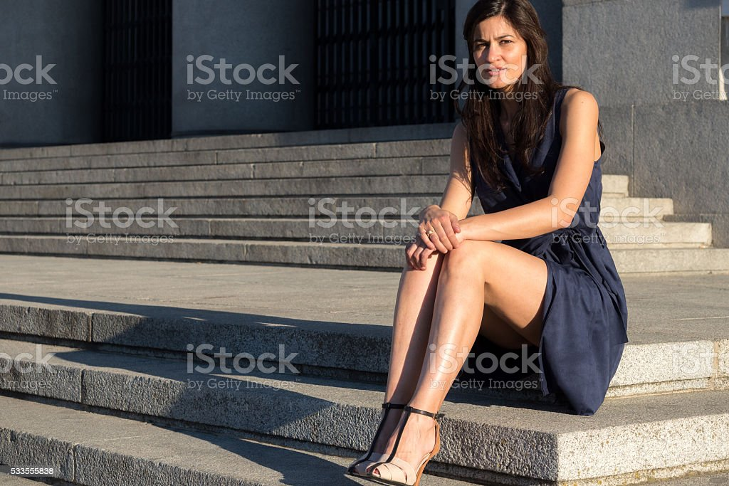 Beautiful dark hair woman with very nice legs stock photo