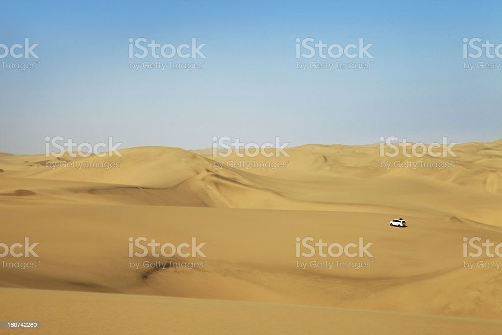 Beautiful Desert Landscape with Vehicle in distance, Swakopmund,Namibia, Africa stock photo