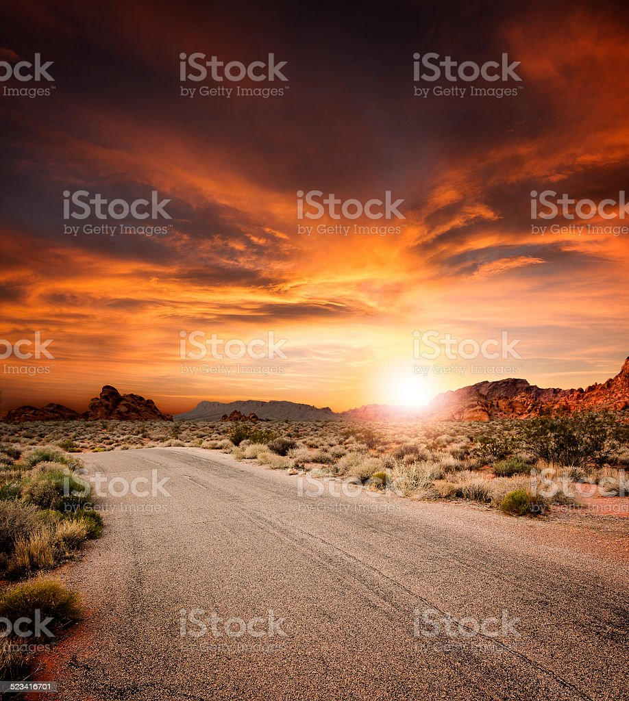 Beautiful Desert Road At Sunset stock photo