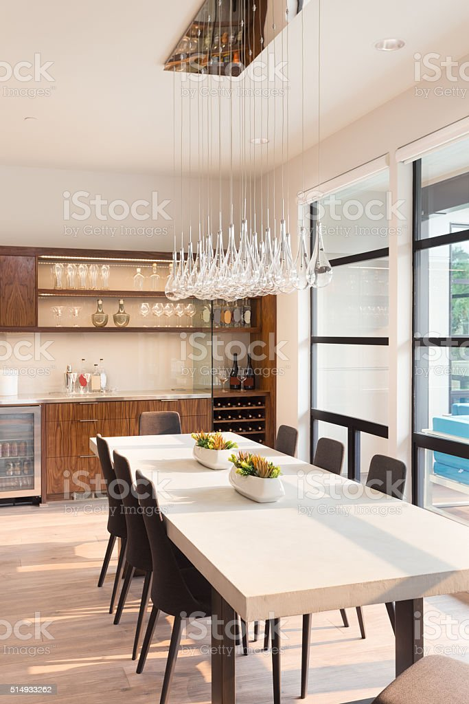 beautiful dining room in new luxury home stock photo