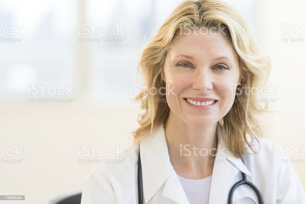Beautiful Doctor Smiling In Clinic stock photo