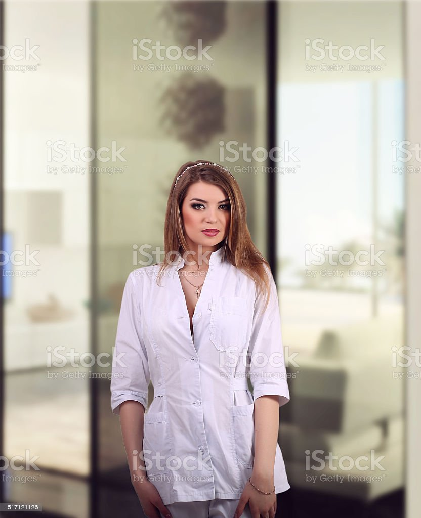 Beautiful doctor standing in a hospital royalty-free stock photo