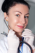 Beautiful doctor with her stethoscope and protective gloves