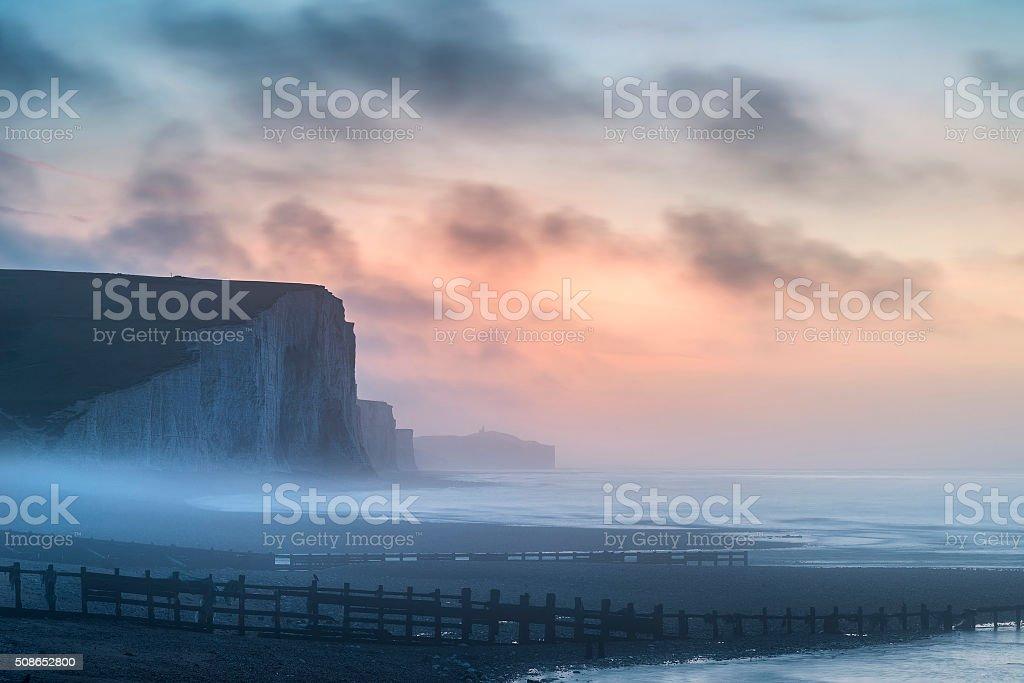 Beautiful dramatic foggy Winter sunrise Seven Sisters cliffs lan stock photo