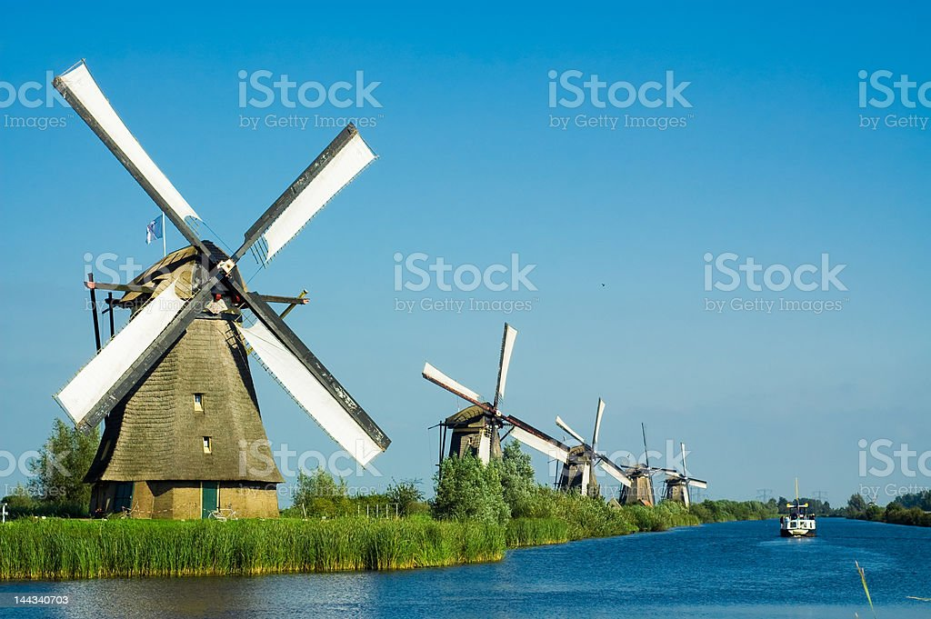 beautiful dutch windmill landscape stock photo