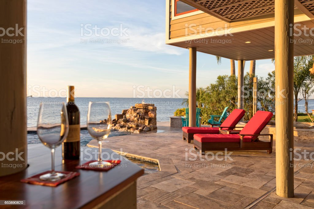 Beautiful Early Evening by the Swimming Pool in Tropical Setting stock photo