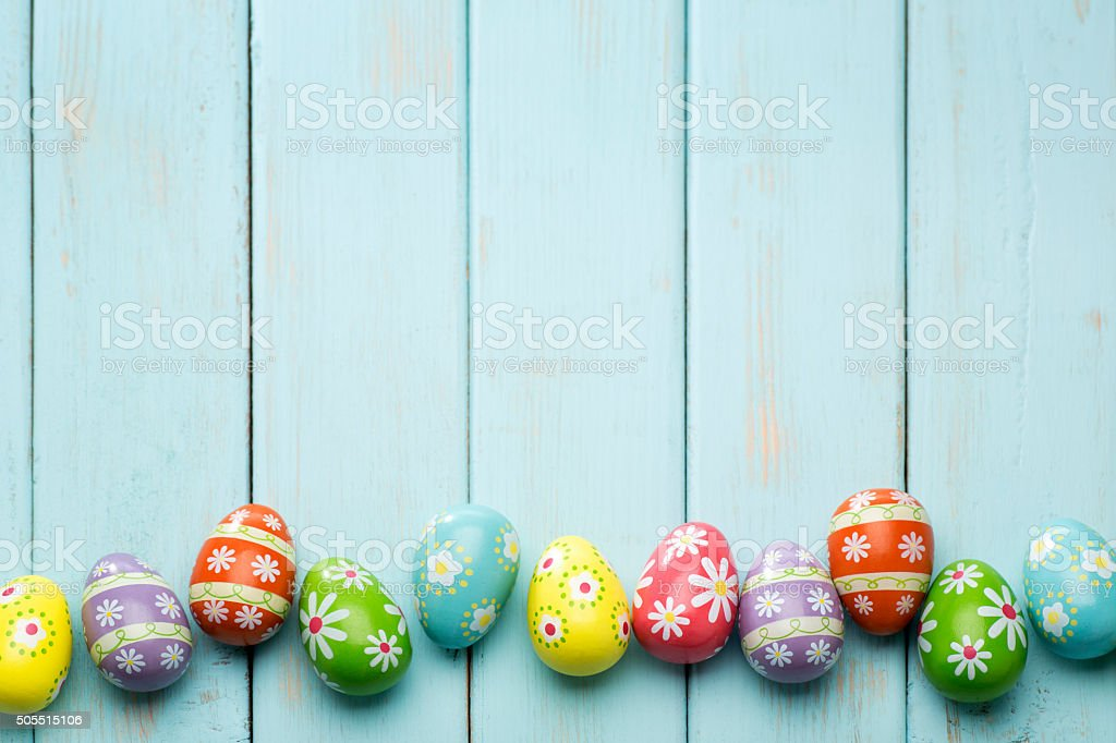 Beautiful Easter Eggs on a Retro Powder Blue Wood background. stock photo