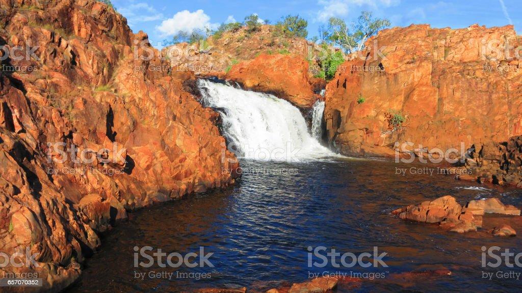 Beautiful Edith Falls waterfall with red rocks in the Nitmiluk National Park, Northern Territory NT, Australia near Pine Creek stock photo