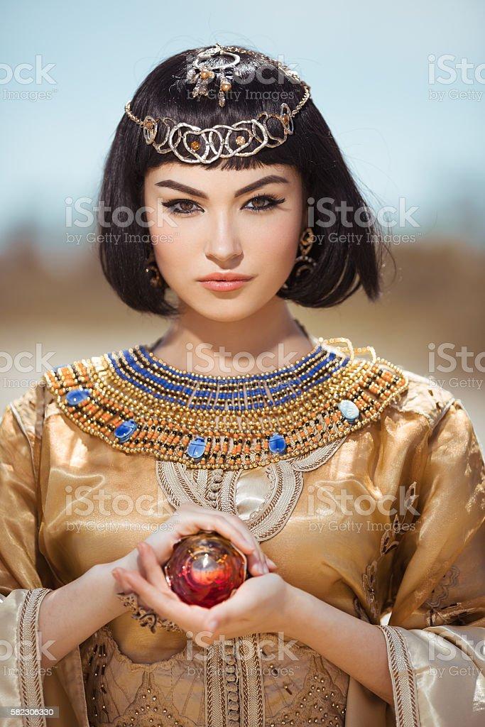 Beautiful Egyptian woman like Cleopatra outdoor stock photo