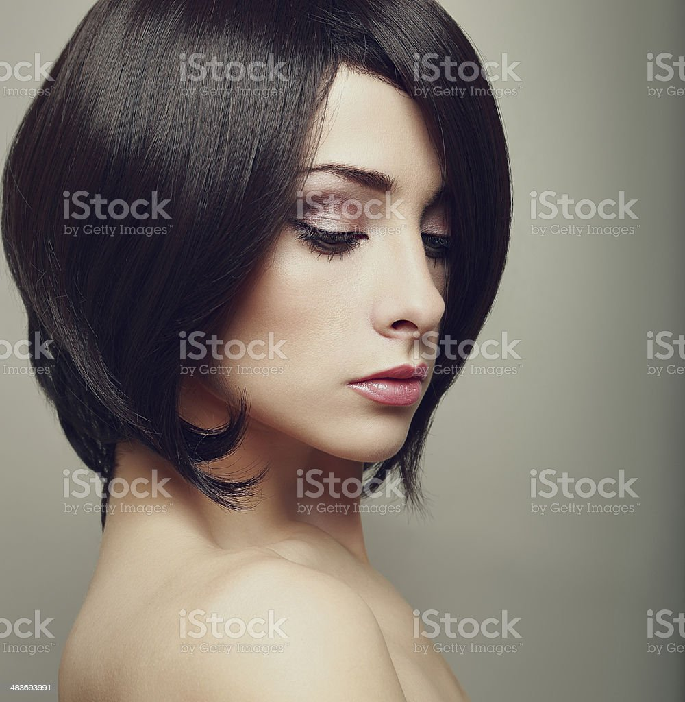 Beautiful elegant female with black short hair. Closeup art portrait stock photo