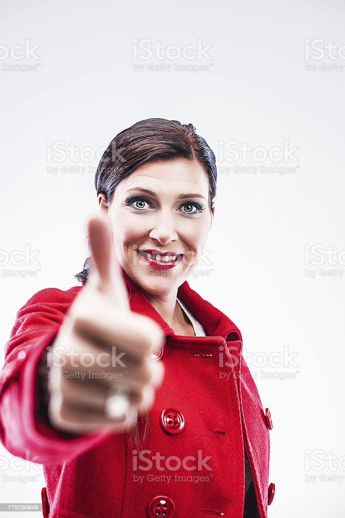 Beautiful elegant woman doing thumbs up royalty-free stock photo