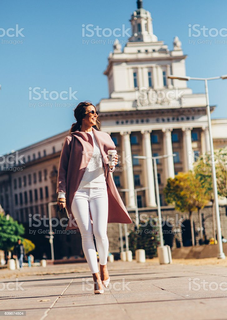 Beautiful elegant woman drinking coffee stock photo