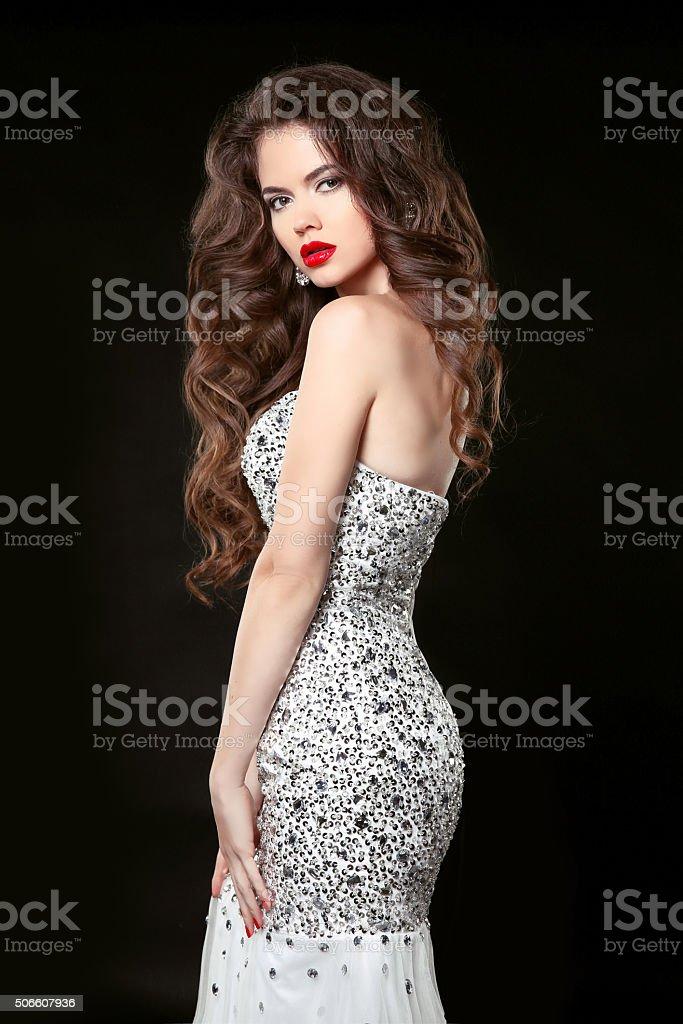 Beautiful elegant woman in fashion dress isolated on black stock photo