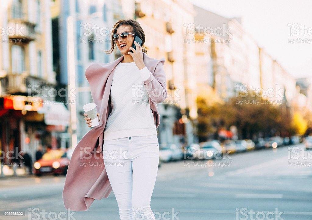 Beautiful elegant woman talking on the phone stock photo