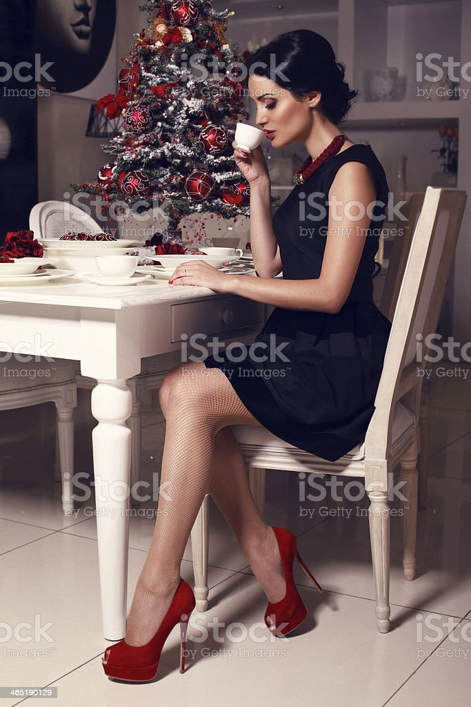 beautiful elegant woman with black hair drinking tea stock photo