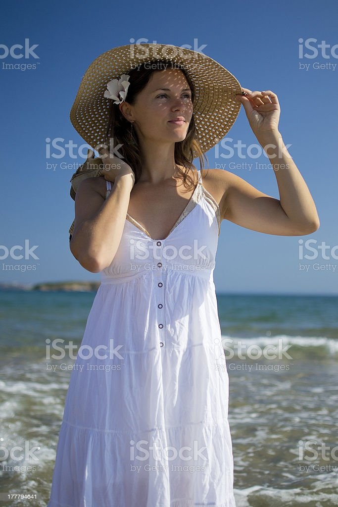Beautiful elegant young woman on the beach royalty-free stock photo