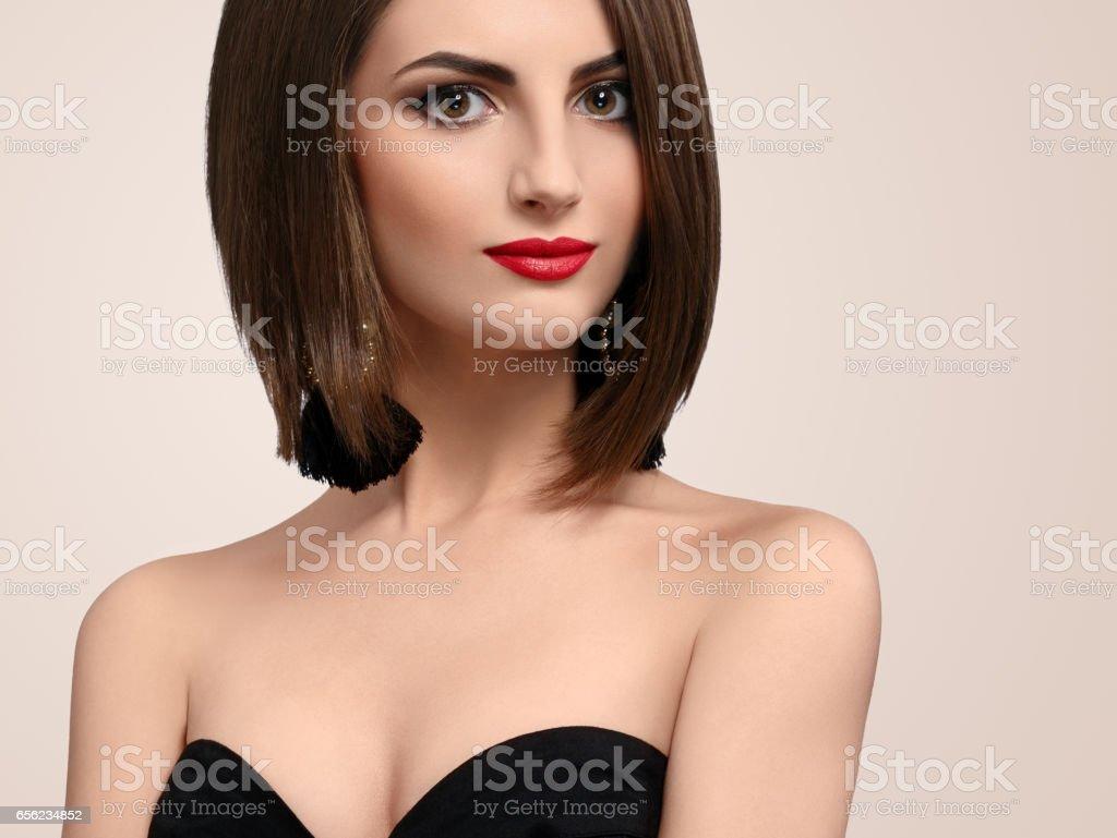 Beautiful elegant young woman posing in studio stock photo