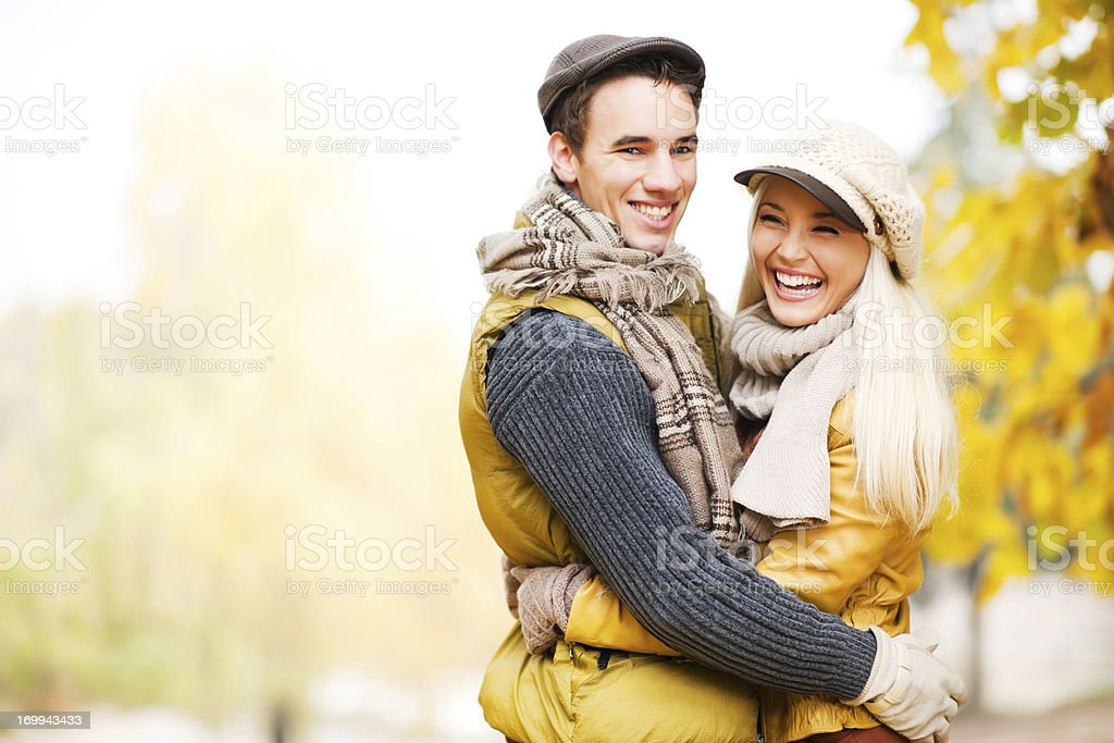 Beautiful embraced couple in the park royalty-free stock photo