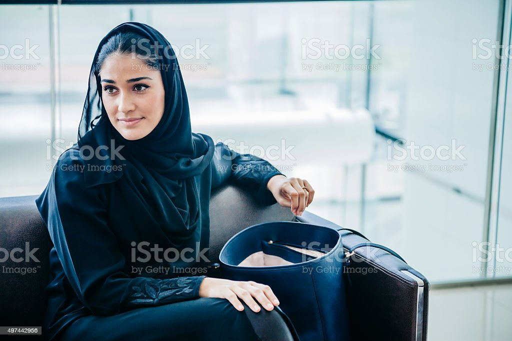 Beautiful Emirati woman at lounge stock photo