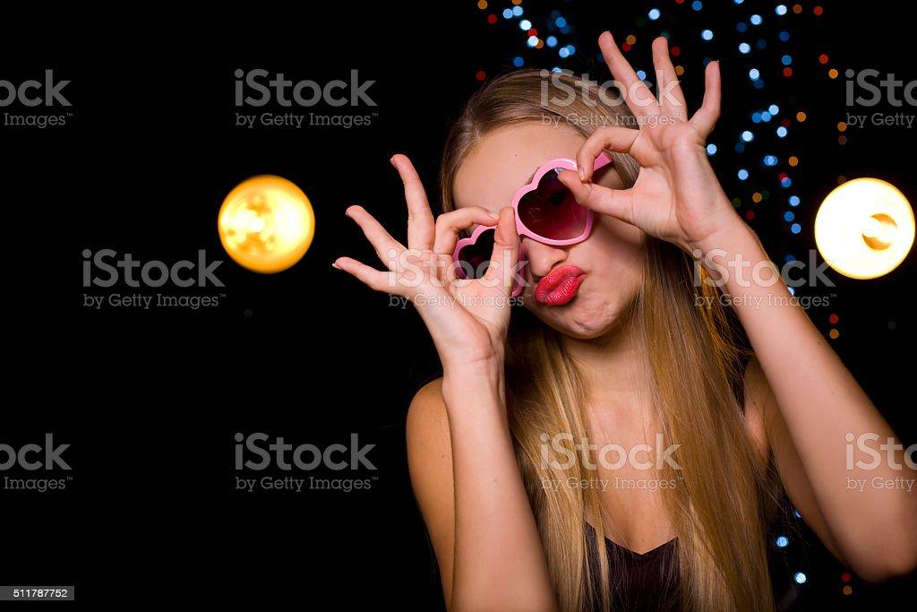 Beautiful emotional blonde in a nightclub at disco stock photo