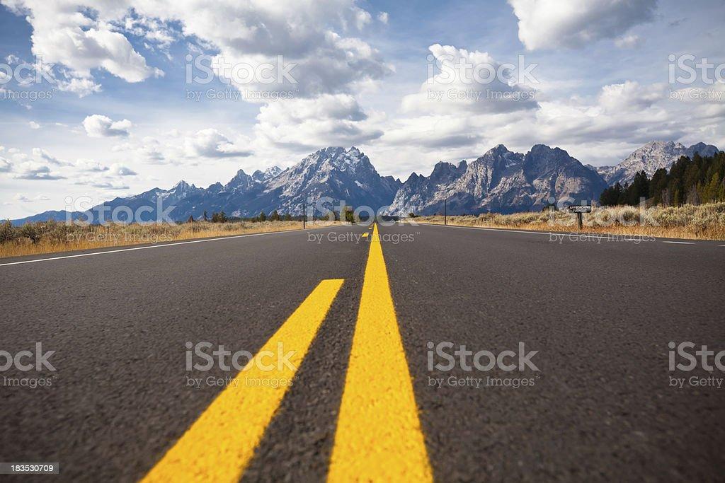 Beautiful Empty Road to  the Tetons stock photo