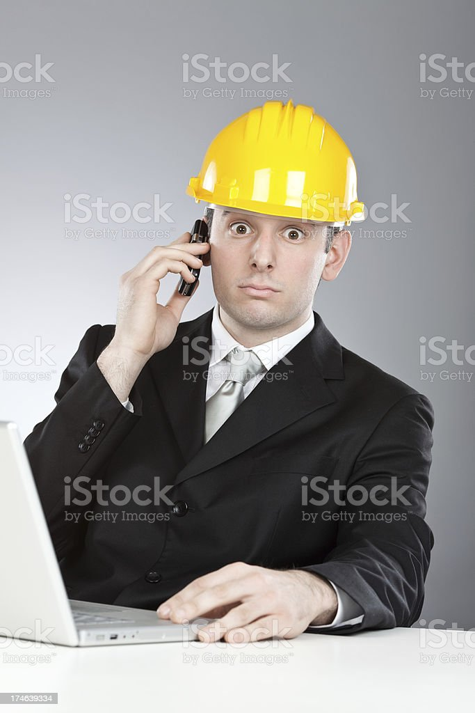beautiful engineer with yellow helmet  laptop and mobile phone stock photo