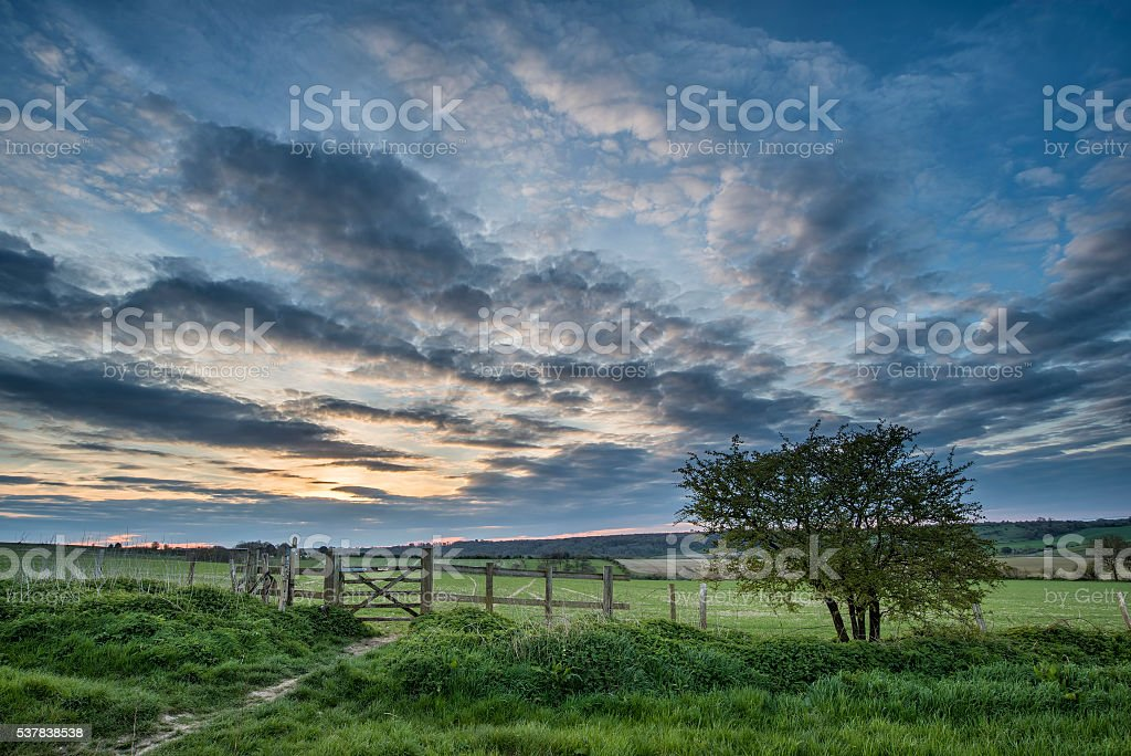 Beautiful English countryside landscape over fields at sunset stock photo