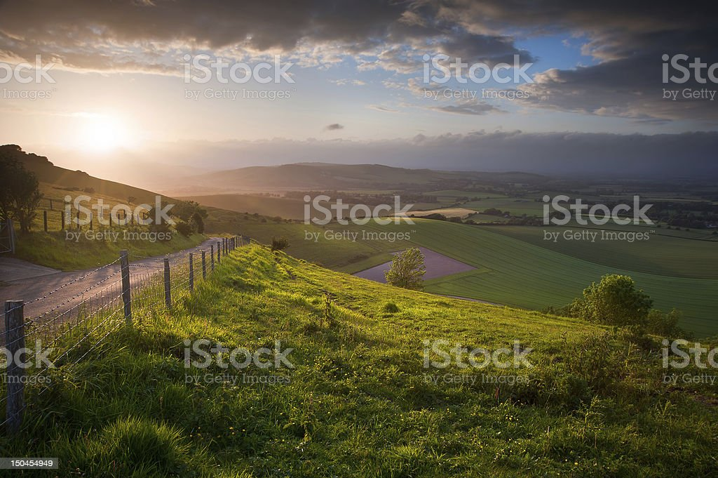 Beautiful English countryside landscape over rolling hills stock photo