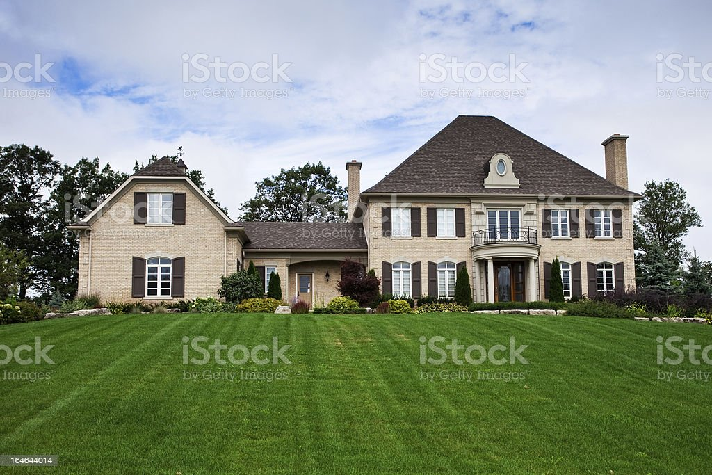 A beautiful estate home front yard stock photo