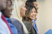 Beautiful ethnic businesswoman in conference looking into camera