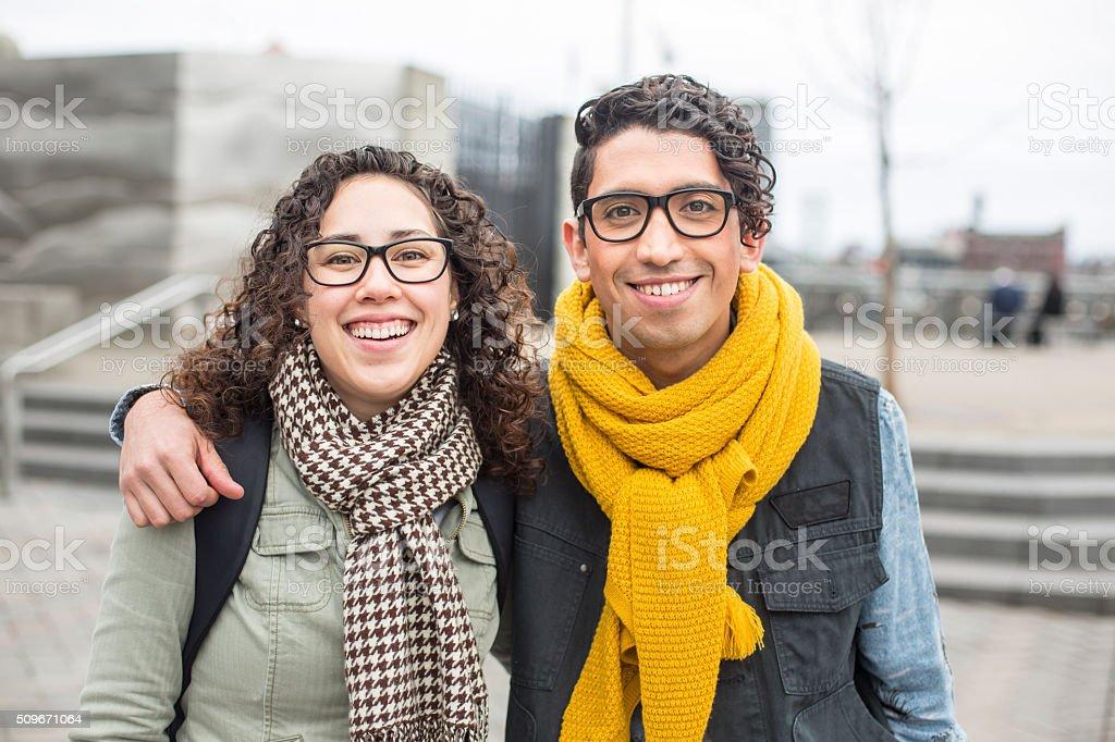 Beautiful ethnic couple enjoying the cold weather and city life stock photo