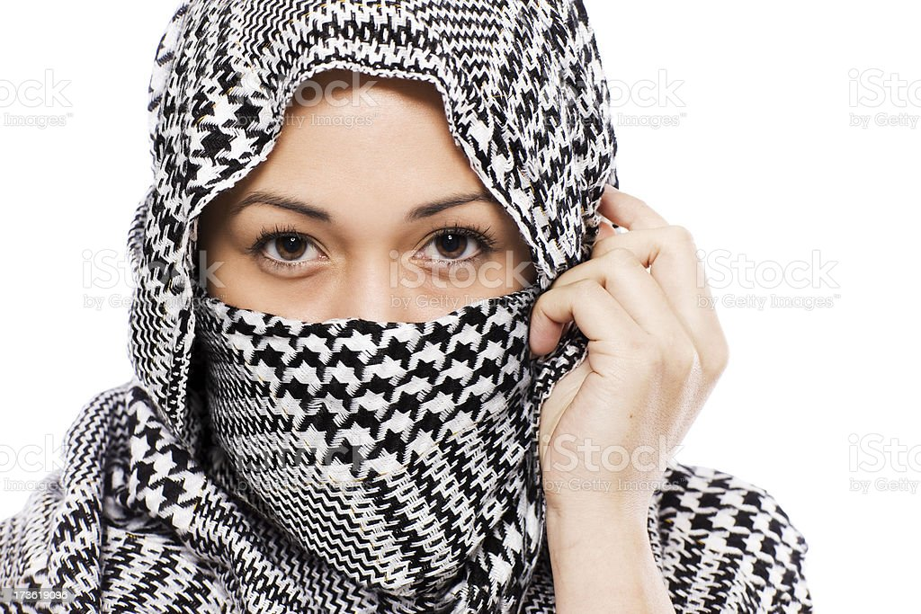 Beautiful Ethnic Young Woman Wrapped in Scarf, Eyes Only, Copyspace royalty-free stock photo