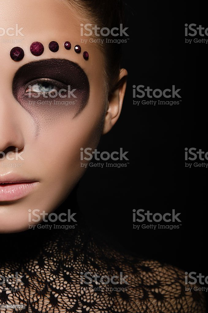 beautiful european woman with face art and decorations stock photo